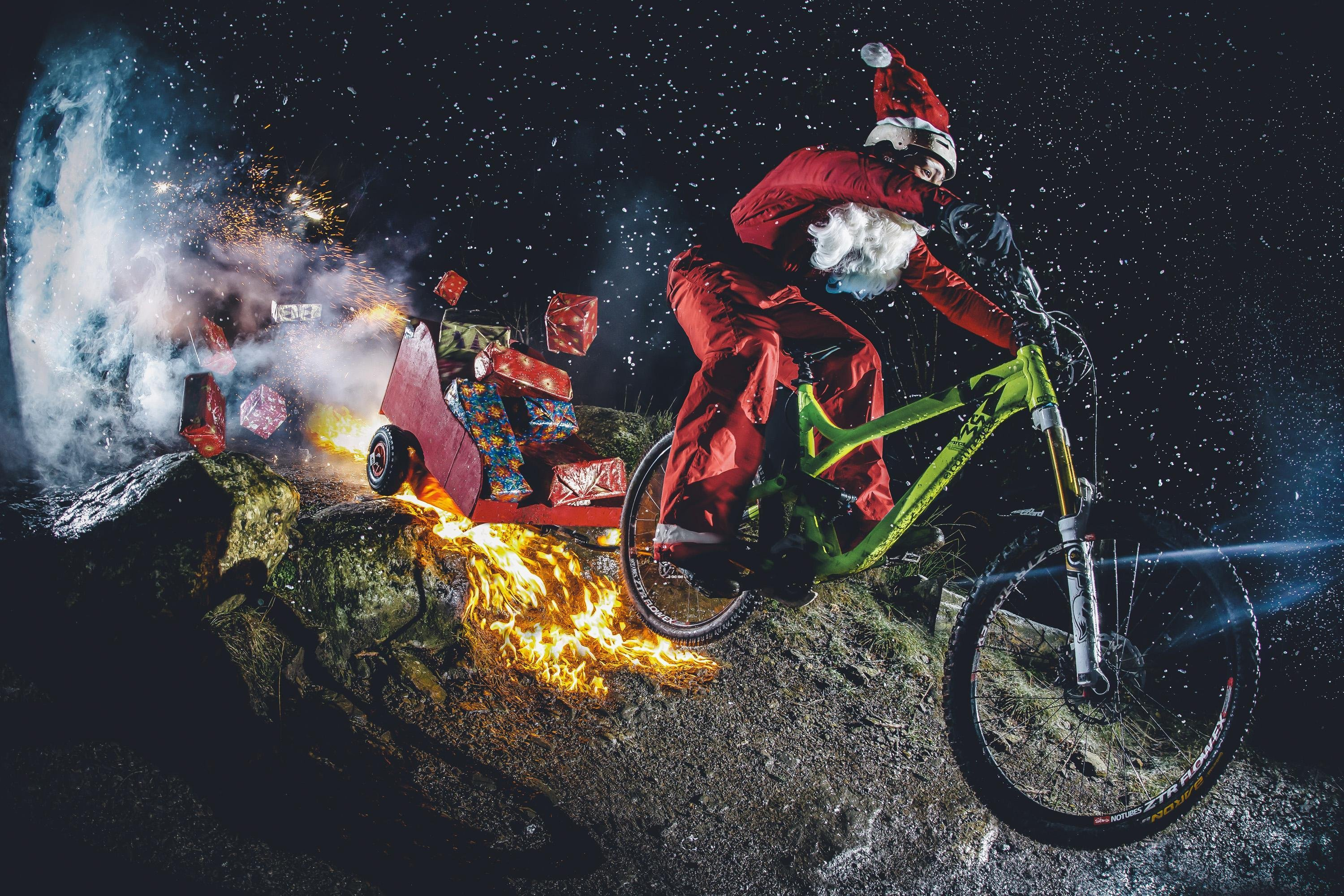 rad-santa-rides-his-mtb-and-sleigh-through-some-fireworks.jpg